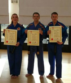 Monika and Iain show off their 1st Dan certificates (with Rob McPhee 3rd Dan, centre)