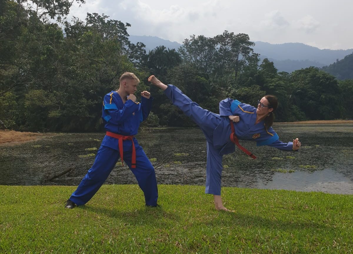Clare performs a side kick in the Lake Gardens