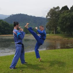 Iain Snr performs front kick in the Lake Gardens